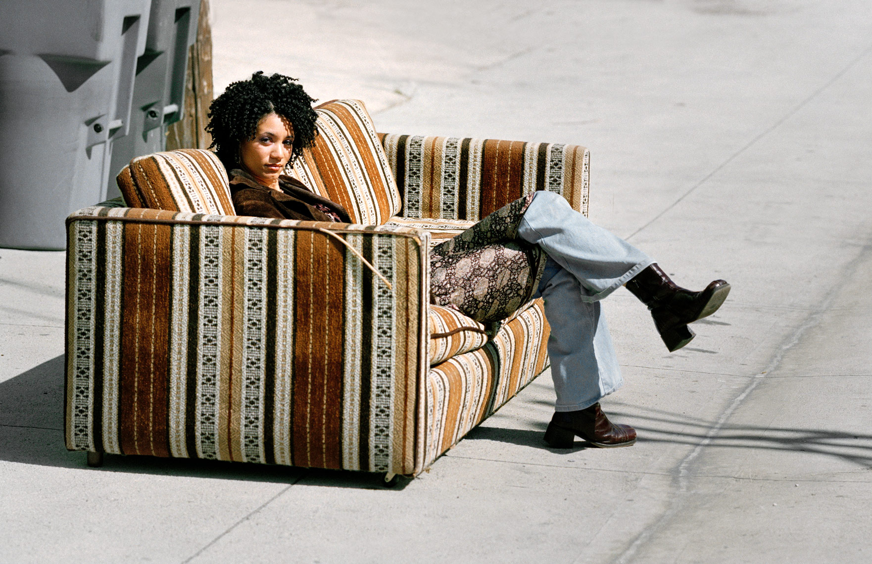 WEB_8.4_Woman-on-Couch-in-Alley